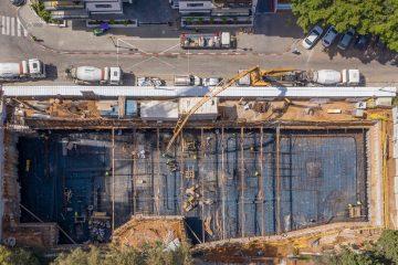 מטרופוליס: משישה בניינים – יצאו תשעה