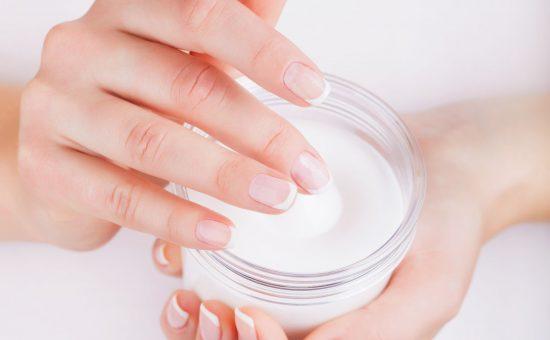36734796 - woman applying cream on hands