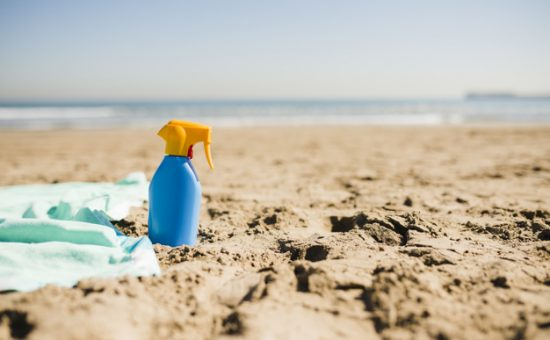 blue-bottle-sun-screen-lotion-sandy-beach_23-2148103021